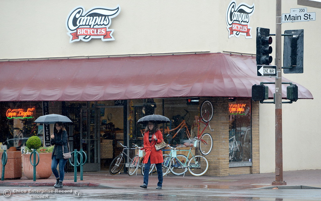 . Umbrellas were in use downtown as rain falls in Chico, Calif. Fri. Nov. 3, 2017. (Bill Husa -- Enterprise-Record)