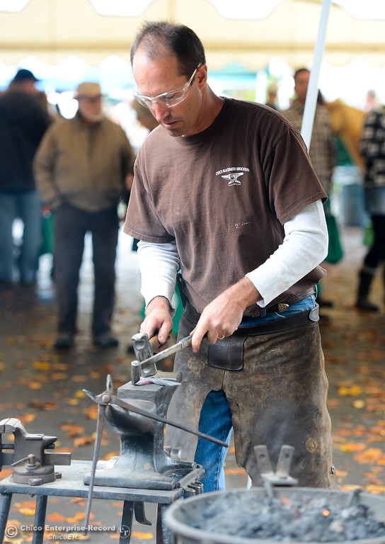 . Doug Maxfield gives a blacksmith demonstration  during the Farm City Celebration Harvest Festival Saturday November 4, 2017 at the Bidwell Mansion in Chico, California. (Emily Bertolino -- Enterprise-Record