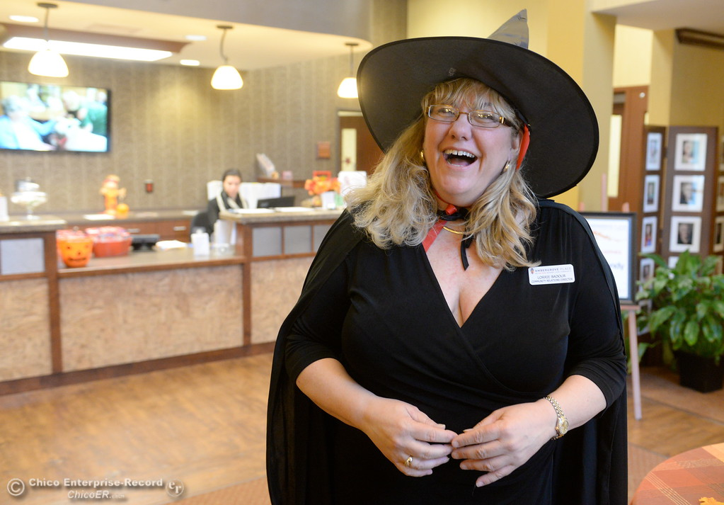 . Community Relations Director Lorrie Badour smiles as she greets students in Beth Geise\'s 5th grade Class at Hooker Oak to play games, make cookies and visit with residents during a Halloween celebration at Amber Grove Place in Chico, Calif. Tues. Oct. 31, 2017. (Bill Husa -- Enterprise-Record)