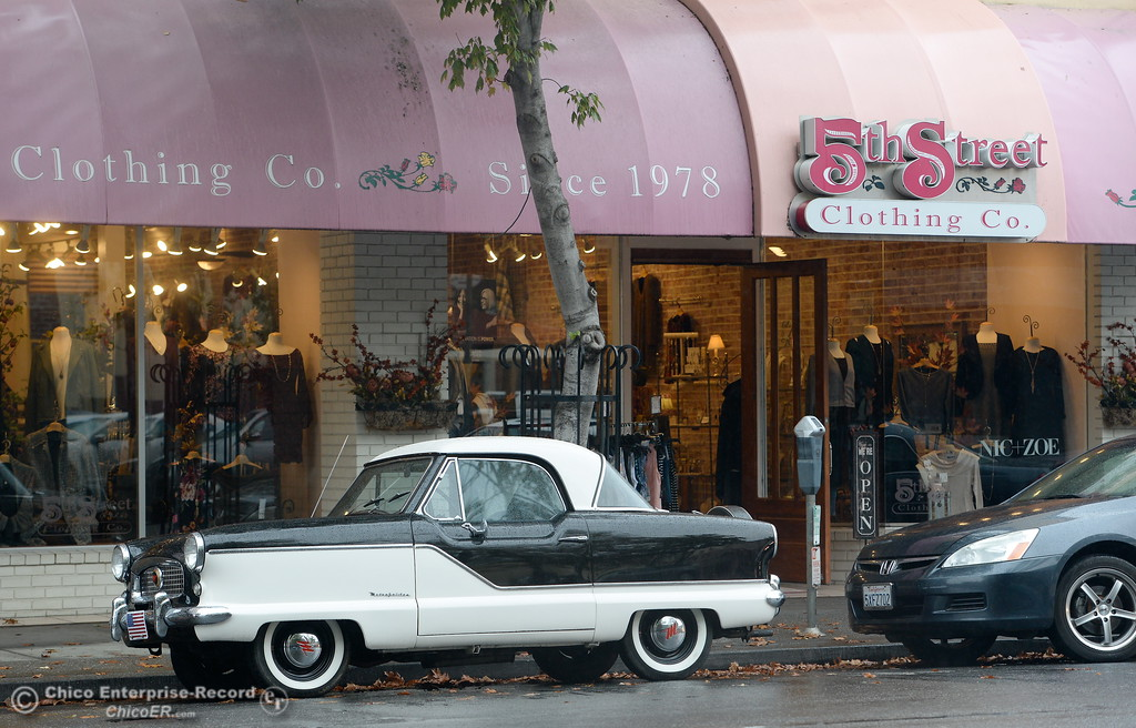 . An interesting vehicle is seen in front of 5th Street Clothing as rain falls in Chico, Calif. Fri. Nov. 3, 2017. (Bill Husa -- Enterprise-Record)
