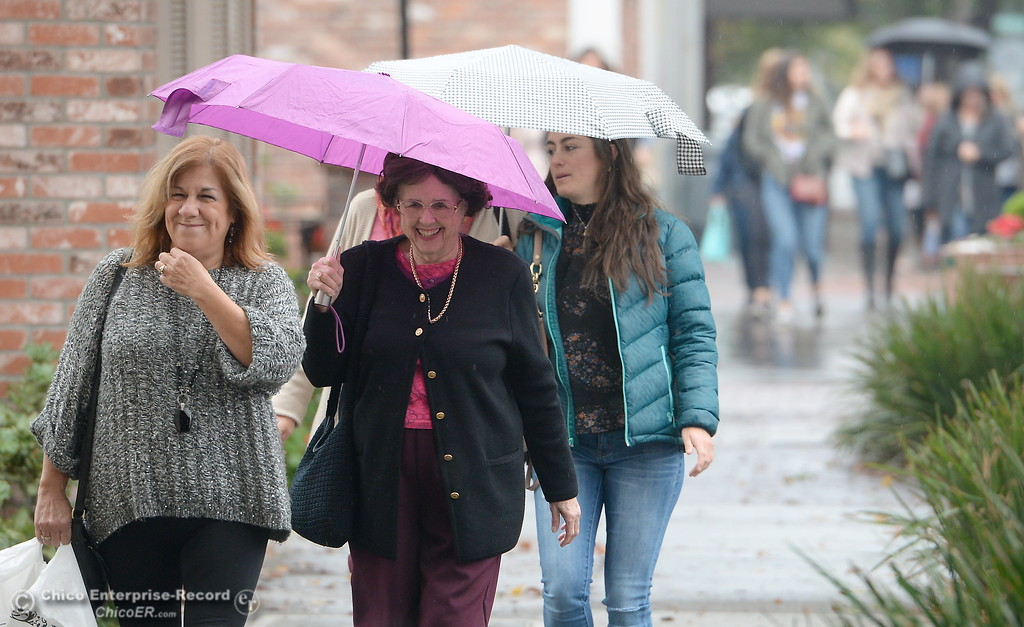. Margaret Schmidt left and her Mom Leaia Anne Pina walk along Third Street as rain falls in Chico, Calif. Fri. Nov. 3, 2017. (Bill Husa -- Enterprise-Record)