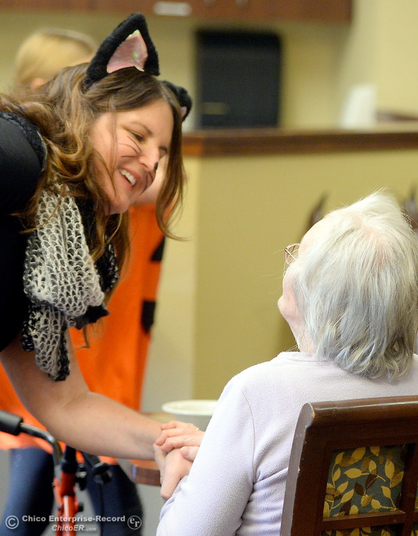 . Teacher Beth Geise at left, along with her 5th grade Class from Hooker Oak School play games, make cookies and visit with residents during a Halloween celebration at Amber Grove Place in Chico, Calif. Tues. Oct. 31, 2017. (Bill Husa -- Enterprise-Record)