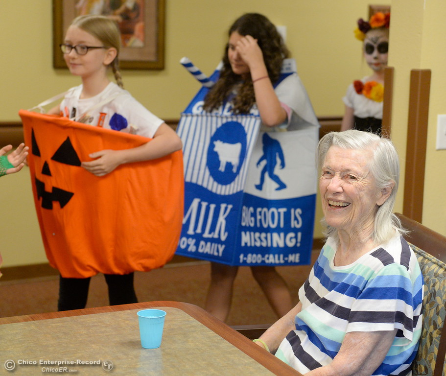 . A resident named Jean smiles as students in Beth Geise\'s 5th grade Class at Hooker Oak play games, make cookies and visit with residents during a Halloween celebration at Amber Grove Place in Chico, Calif. Tues. Oct. 31, 2017. (Bill Husa -- Enterprise-Record)