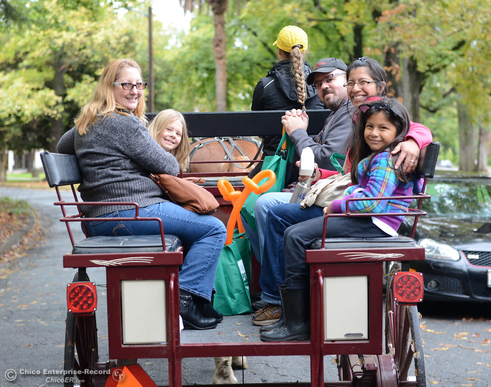 . Families enjoy a horse drawn carriage ride around Bidwell Mansion during the Farm City Celebration Harvest Festival Saturday November 4, 2017 at the Bidwell Mansion in Chico, California. (Emily Bertolino -- Enterprise-Record)