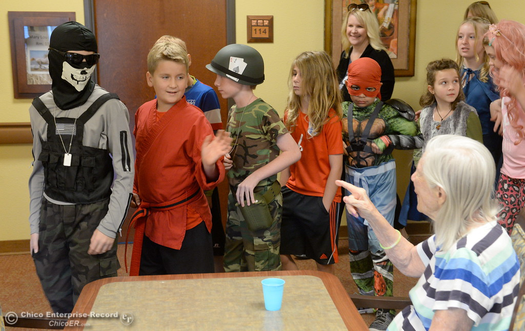 . A resident named Jean points as students in Beth Geise\'s 5th grade Class at Hooker Oak play games, make cookies and visit with residents during a Halloween celebration at Amber Grove Place in Chico, Calif. Tues. Oct. 31, 2017. (Bill Husa -- Enterprise-Record)