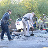 Officers clear the road of debris after two people died in a head-on crash Tuesday, Nov. 1, 2016, on Highway 99 north of Meridian Road in Chico, California. (Dan Reidel -- Enterprise-Record)