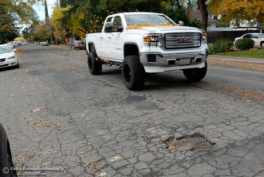 . A large truck moves to the middle of the road to avoid a rough, pothole infested section of Rio Lindo Ave. in Chico, Calif. Monday Nov. 27, 2017. As part of our survey on how the gas tax windfall should be spent, we\'re asking readers what roads should be fixed first. (Bill Husa -- Enterprise-Record)