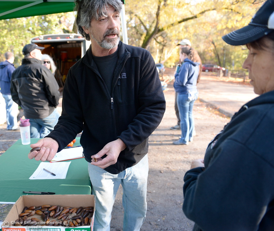 . Naturalist Robert Dresden talks about how the acorns were harvested and prepared before planting Tuesday.   Chico Tree Advocates and the City of Chico plant Valley Oak acorns around One Mile Recreation Area of Bidwell Park Tues. Nov. 28, 2017. (Bill Husa -- Enterprise-Record)