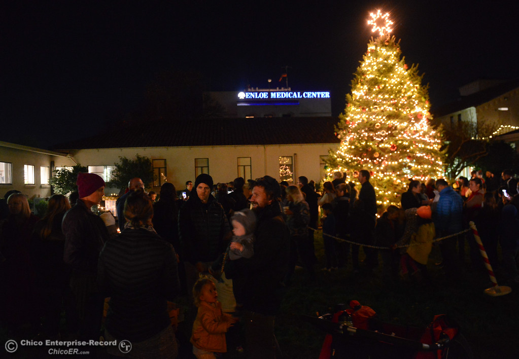 . People gather and listen to Christmas music and share in the holiday spirit during Enloe\'s annual tree lighting ceremony Tuesday November 28, 2017 in Chico, California. (Emily Bertolino -- Enterprise-Record)