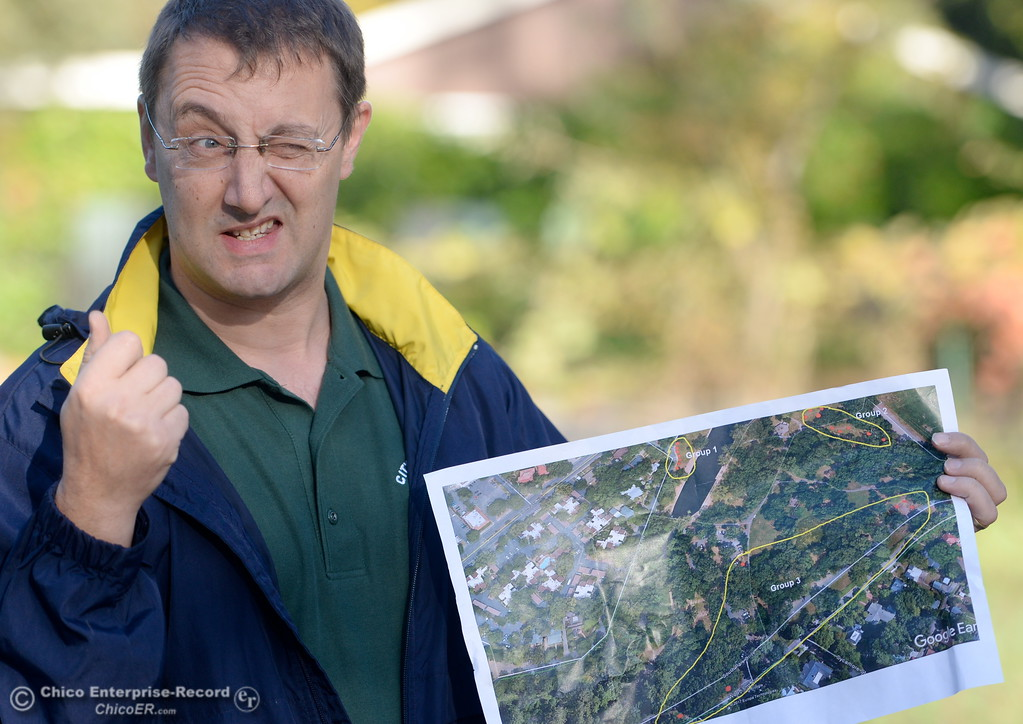 . City of Chico Urban Forest Manager Richie Bamlet talks about the planting process while holding a map of the areas within the park that Chico Tree Advocates and the City of Chico will plant Valley Oak acorns around One Mile Recreation Area of Bidwell Park Tues. Nov. 28, 2017. (Bill Husa -- Enterprise-Record)