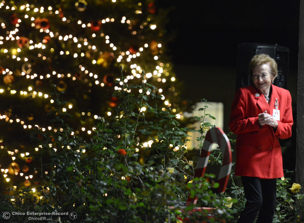 . Sherlie Albers lights the Christmas Tree during Enloe\'s annual tree lighting ceremony. Aside from being an Enloe volunteer for 27 years, Sherlie\'s father, Everett Weldin was the first baby Dr. Newton Thomas Enloe delivered at the original Enloe Medical Center in 1901 Tuesday November 28, 2017 in Chico, California. (Emily Bertolino -- Enterprise-Record)