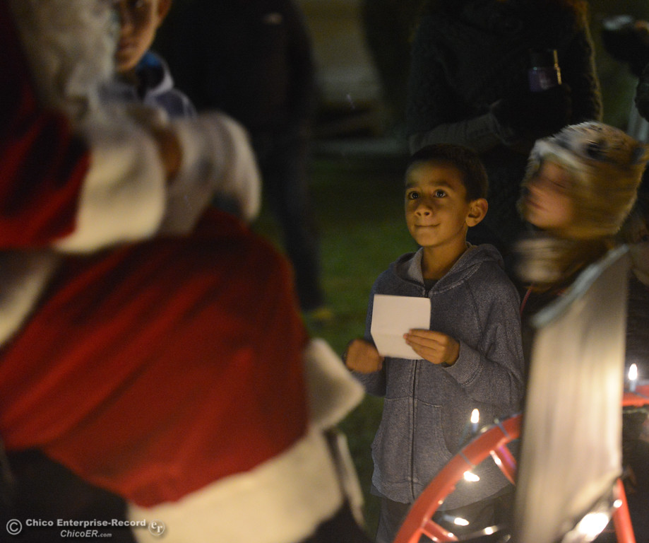 . Jayson Kuhne, 7, waits with his Christmas wish list to talk to Santa Claus during Enloe\'s annual tree lighting ceremony Tuesday November 28, 2017 in Chico, California. (Emily Bertolino -- Enterprise-Record)