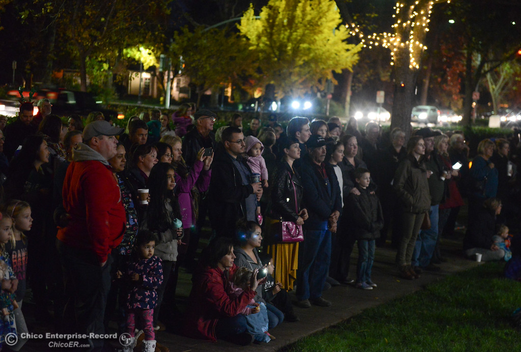. People gather and listen to Christmas music during Enloe\'s annual tree lighting ceremony Tuesday November 28, 2017 in Chico, California. (Emily Bertolino -- Enterprise-Record)