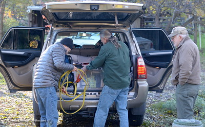 Veterans for Peace members Barry Binks left and Richard Gilchrist right of Chico get a little help from veteran Robert Trausch as they load up a Toyota 4Runner as they prepare to head to North Dakota in support of the Standing Rock Sioux in a battle to protect their water from an oil pipeline company project Thurs. Dec. 1, 2016. (Bill Husa -- Enterprise-Record)
