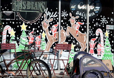 Decorative holiday paintings of elves having fun are seen on the windows at Has Beans on Main St. in downtown Chico, Calif. Thurs. Dec. 1, 2016. (Bill Husa -- Enterprise-Record)