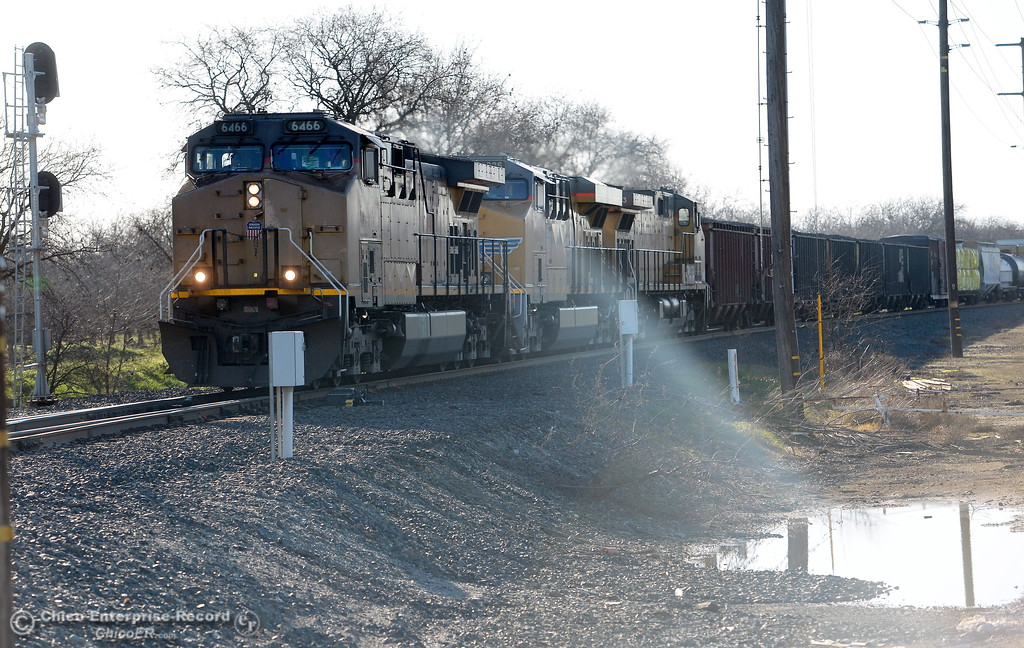 . A train rolls along the tracks at the Hegan Lane intersection after a fire at a trestle over Comanche Creek Tues. Feb. 6, 2018. Apparently the damaged trestle was still able to allow this train to pass over it Tuesday morning. (Bill Husa -- Enterprise-Record)