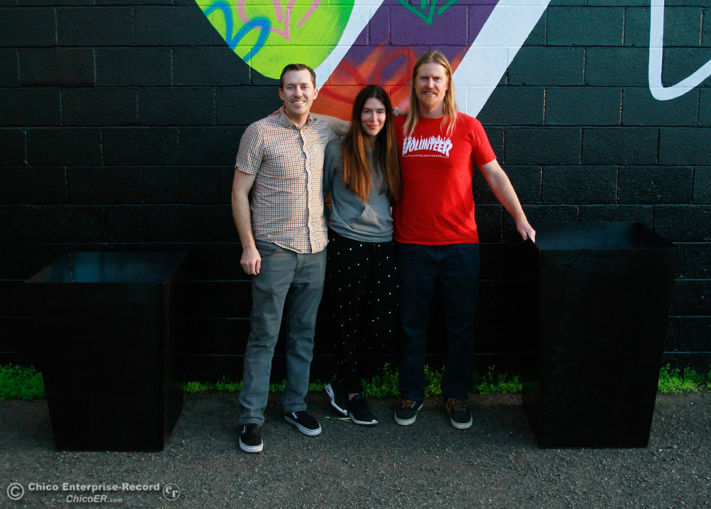 . Aaron Davidson of Alive Product Design, Lulus\' president Colleen Winter and Scott Bailey of Chico Skatepark Solutions stand next to decorative planters gifted to Lulus from Chico Skatepark Solutions, Friday, February 9, 2018, in Chico, California. (Carin Dorghalli -- Enterprise-Record)