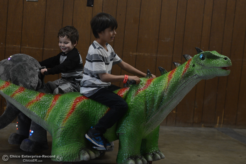 . Zayden Moreno and his brother, Omari Moreno, ride dinosaur and elephant go carts during the Jurassic Tour, Saturday, February 10, 2018, in Chico, California. (Carin Dorghalli -- Enterprise-Record)