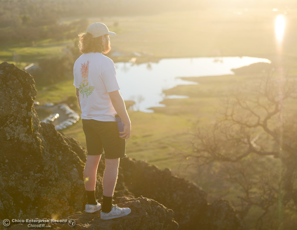 . Connor Shae looking out over Horseshoe Lake during the golden hour, Thursday, February 8, 2018, in Chico, California. (Carin Dorghalli -- Enterprise-Record)