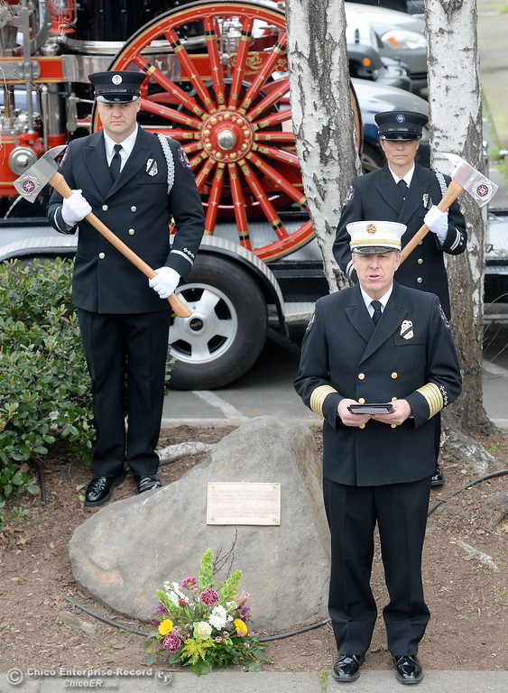 . Chico Fire Chief Steve Standridge speaks to the crowd along with Chico Firefighters as they remember the on-duty death of Fire Marshal Ray Head on this day in 1970 at the site of a memorial plaque in his honor along Broadway Street in downtown Chico, Calif. Wednesday Feb. 14, 2018. (Bill Husa -- Enterprise-Record)