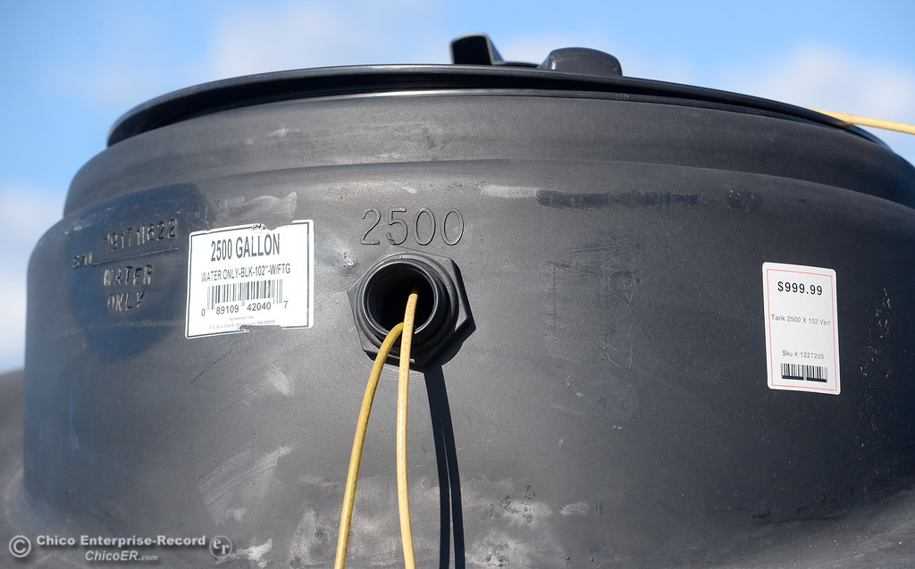 . Water storage tanks are seen outside of Tractor Supply Co. in Chico, Calif. Monday Feb. 12, 2018. If voters approve Proposition 72,  which became the fifth statewide ballot measure to qualify for Californiaís June 5 primary election ó property owners who install rainwater capture systems wonít be required to have their property reassessed as the law now requires, saving them from paying higher property taxes.  (Bill Husa -- Enterprise-Record)