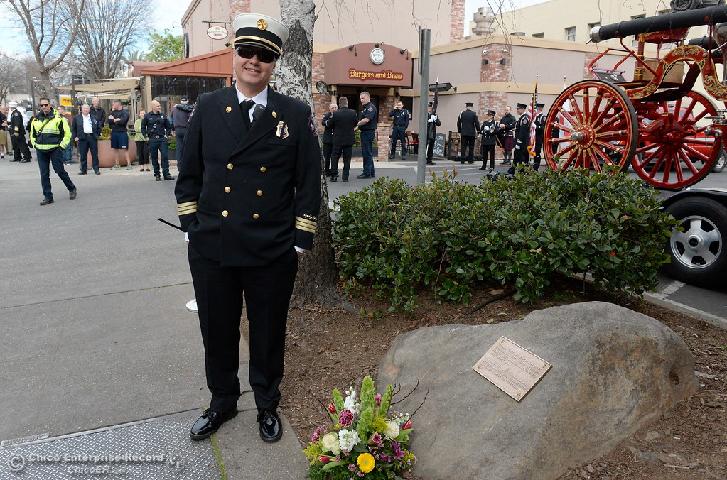 . Division Chief Aaron Lowe smiles beside the memorial marker as Chico Firefighters remember the on-duty death of Fire Marshal Ray Head on this day in 1970 at the site of a memorial plaque in his honor along Broadway Street in downtown Chico, Calif. Wednesday Feb. 14, 2018. (Bill Husa -- Enterprise-Record)