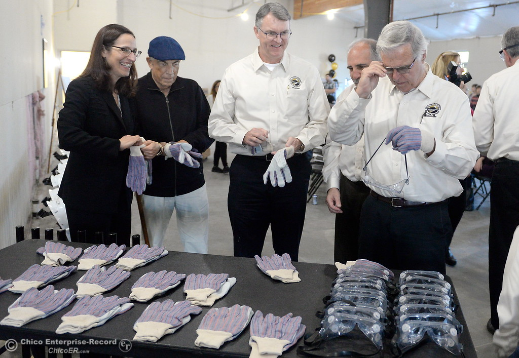 ". At left, Butte College President Dr. Samia Yaqub gets her gloves and goggles along with other Butte College VIP\'s as they get ready to start the demolition process with a ceremonial ""wall breaking\"" by President Yaqub and several others. (Bill Husa -- Enterprise-Record)"