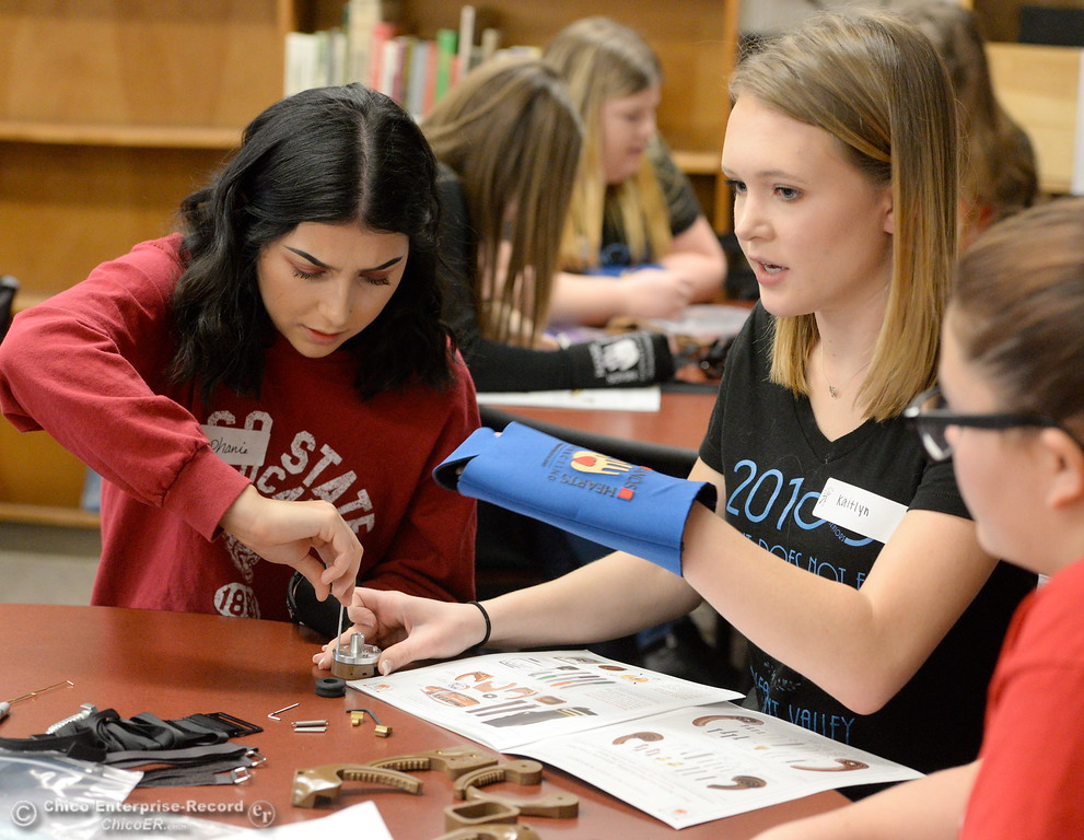 . Using only one hand each Pleasant Valley High and Chico High School students enrolled in the capstone course of the medical pathway build articulated hands to be donated to children abroad Wednesday Feb. 14, 2018.  (Bill Husa -- Enterprise-Record)