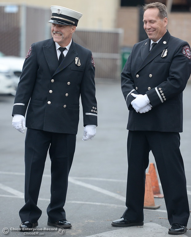 . Chico Fire Captain David Main, left and Chico Fire Captain Mike Murphy smile as Chico Firefighters remember the on-duty death of Fire Marshal Ray Head on this day in 1970 at the site of a memorial plaque in his honor along Broadway Street in downtown Chico, Calif. Wednesday Feb. 14, 2018. (Bill Husa -- Enterprise-Record)