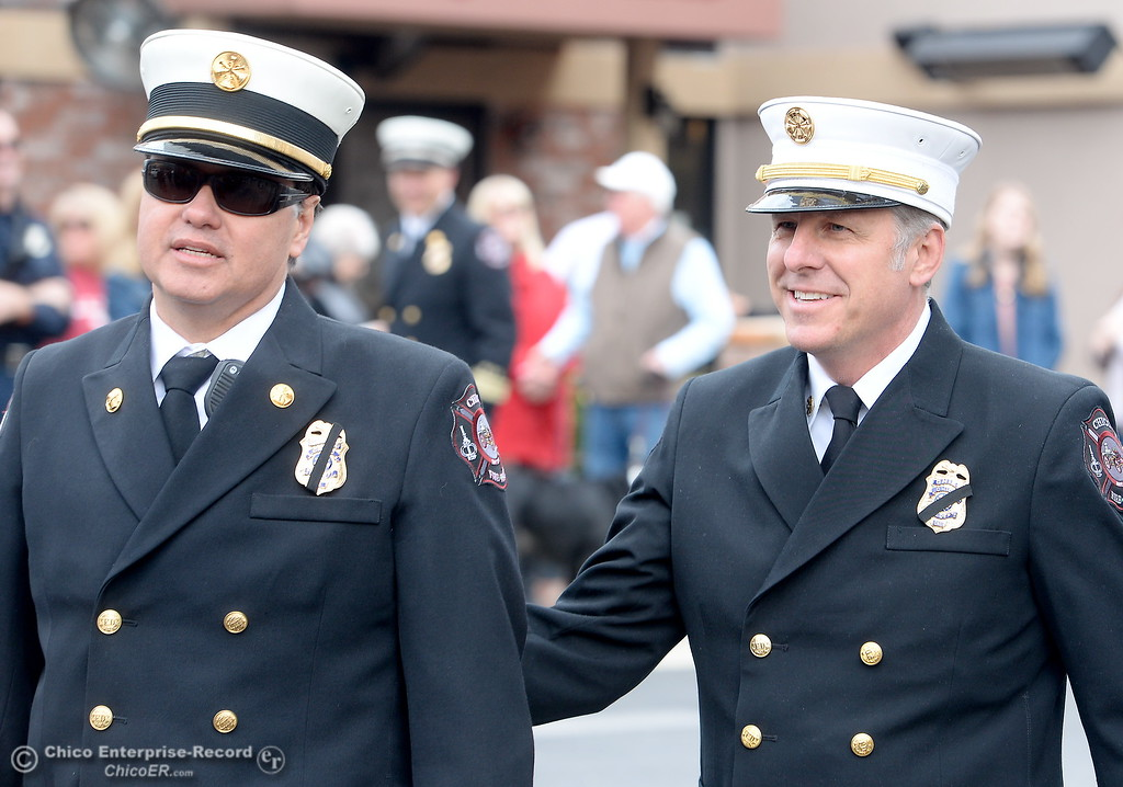 . Division Chief Aaron Lowe, left and Fire Chief Steve Standridge smile as Chico Firefighters remember the on-duty death of Fire Marshal Ray Head on this day in 1970 at the site of a memorial plaque in his honor along Broadway Street in downtown Chico, Calif. Wednesday Feb. 14, 2018. (Bill Husa -- Enterprise-Record)