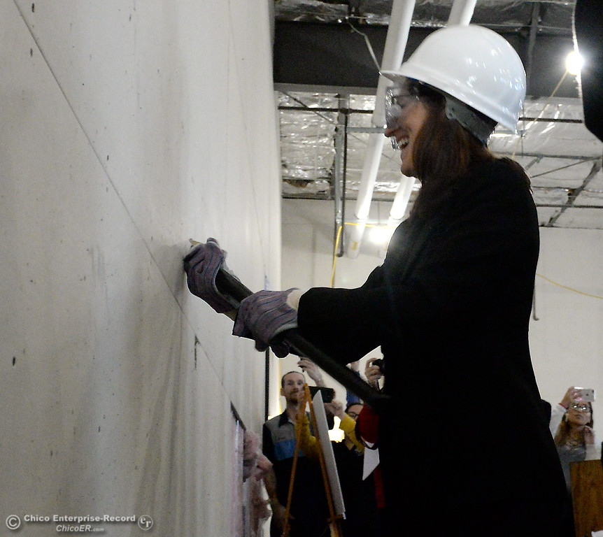 . With the first ceremonial swing of a sledghammer, Butte College President Dr. Samia Yaqub begins the demolition of a wall at the new Automotive Diesel Program at the Butte College Chico Center in Chico, Calif. Wednesday Feb. 14, 2018.   (Bill Husa -- Enterprise-Record)