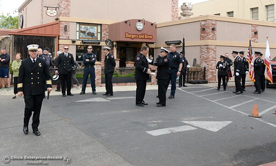 Chico Firefighters gather to remember the on-duty death of Fire Marshal Ray Head on this day in 1970 at the site of a memorial plaque in his honor along Broadway Street in downtown Chico, Calif. Wednesday Feb. 14, 2018. (Bill Husa -- Enterprise-Record)