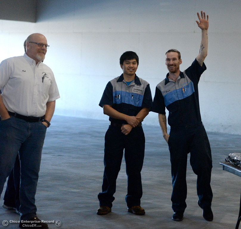 ". At right, David Mauch holds up his hand in response to the question ""who is interested in diesel?\"" At left Rob Holt, Ricky Vang listen as Butte College President Dr. Samia Yaqub talks about the new Automotive Diesel Program at the Butte College Chico Center in Chico, Calif. Wednesday Feb. 14, 2018. The group also started the demolition process with a ceremonial \""wall breaking\"" by President Yaqub and several others. (Bill Husa -- Enterprise-Record)"