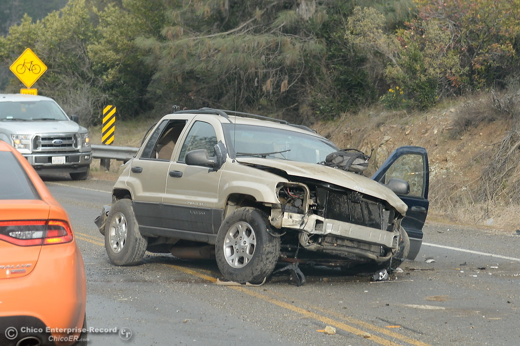 . Highway Patrol officers investigate the scene of an accident near the Magalia Reservoir on Skyway above Paradise, Calif. Thurs. Feb. 22, 2018.  (Bill Husa -- Enterprise-Record)
