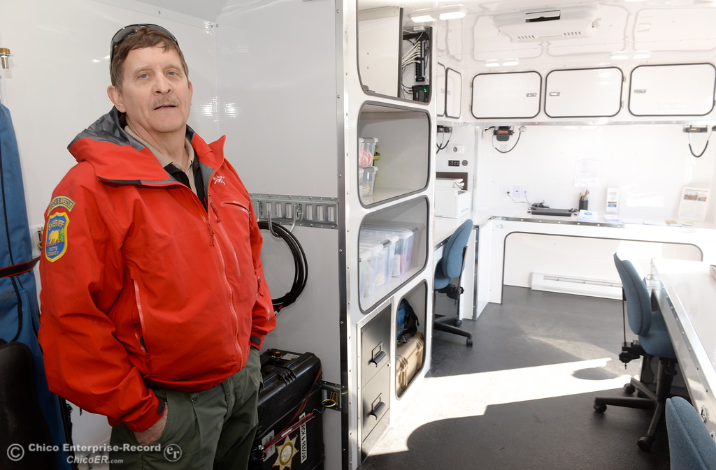 . Public Relations Officer Dennis Schmidt stands inside of the new Mobile Command Center Friday.   Members of the Butte County Search & Rescue gather around their new vehicles prior to a dedication ceremony at the Sheriff\'s Office in Oroville, Calif. Friday Feb. 23, 2018. The new Mobile Command Center is custom built by TPD out of Sacramento and the new Rescue 1 Truck is a fully equipped 2017 Ford F350 Diesel 4wd. According to Dennis Schmidt, Public Relations Officer the new vehicles were obtained through a campaign that lasted 50-days and $50,000 of the $72,000 total raised was given by PG&E. Search & Rescue expect to get around 30-years of service out of the new Command Center. (Bill Husa -- Enterprise-Record)