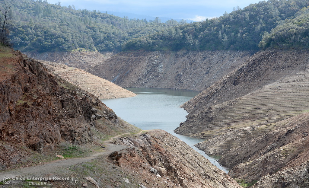 . A low Lake Oroville is seen from the Nelson Bar Day use area below Paradise, Calif. Sunday Feb. 18, 2018.  (Bill Husa -- Enterprise-Record)
