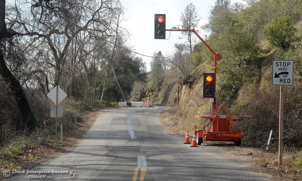 . A temporary stoplight remains in place along Centerville Road Thurs. Feb. 22, 2018. The stoplight has been in place along Centerville Road after a tree fell taking part of the road with it along Butte Creek more than a year ago on Friday Jan. 20, 2017.  (Bill Husa -- Enterprise-Record)