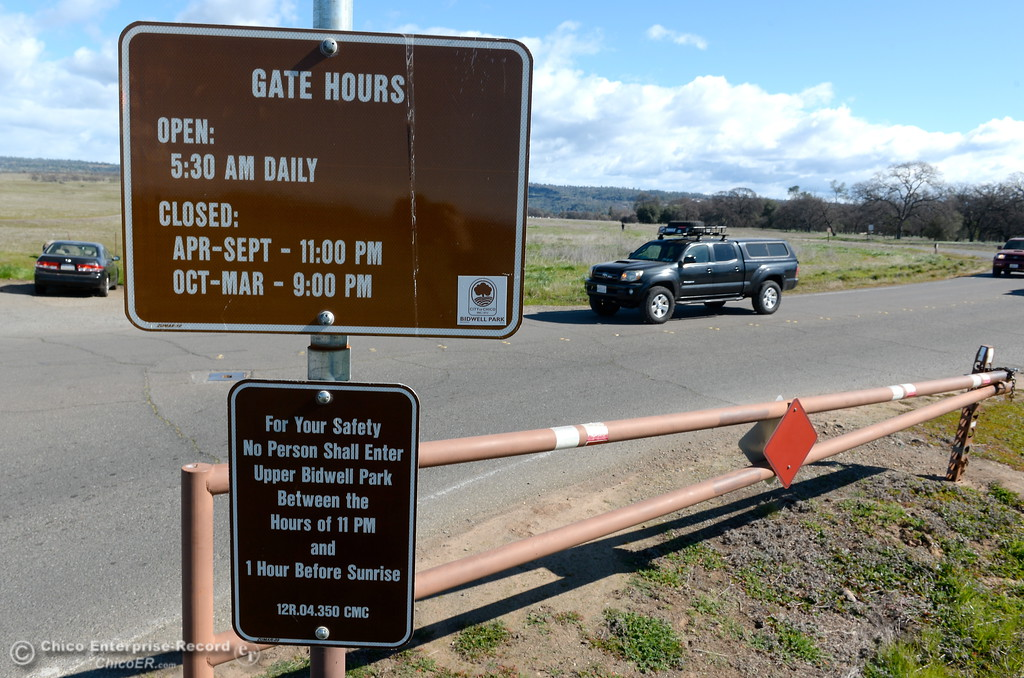 . People drive past the gate to the entrance of Upper Bidwell Park in Chico, Calif. Monday Feb. 19, 2018. The City is distributing a survey asking residents about vehicle access in upper Bidwell Park.  (Bill Husa -- Enterprise-Record)