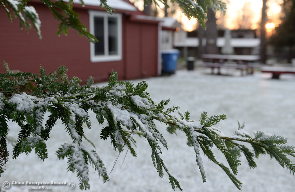 . A dark cloud dropped a dusting of snow below 1,800 in Paradise, Calif. Thursday Feb. 22, 2018. The temperature dropped and the snow froze overnight remaining until Friday morning.  (Bill Husa -- Enterprise-Record)