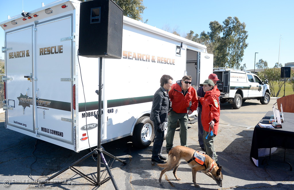 . Members of the Butte County Search & Rescue gather around their new vehicles prior to a dedication ceremony at the Sheriff\'s Office in Oroville, Calif. Friday Feb. 23, 2018. The new Mobile Command Center is custom built by TPD out of Sacramento and the new Rescue 1 Truck is a fully equipped 2017 Ford F350 Diesel 4wd. According to Dennis Schmidt, Public Relations Officer the new vehicles were obtained through a campaign that lasted 50-days and $50,000 of the $72,000 total raised was given by PG&E. Search & Rescue expect to get around 30-years of service out of the new Command Center. (Bill Husa -- Enterprise-Record)