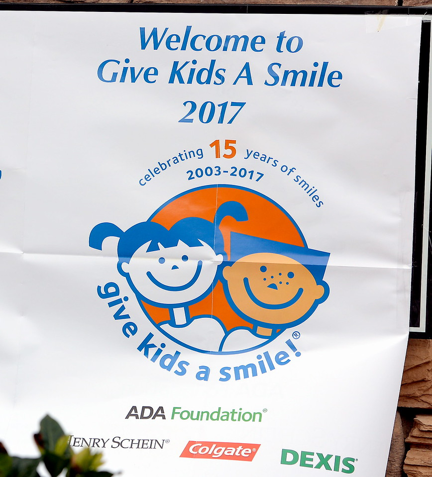 A sign hangs on the front of the office as 15 Dentists and their associated staffs help provide free dental care to needy children during the Youthful Smiles program at Chico Pediatric Dentistry Friday Feb. 3, 2017. (Bill Husa -- Enterprise-Record)