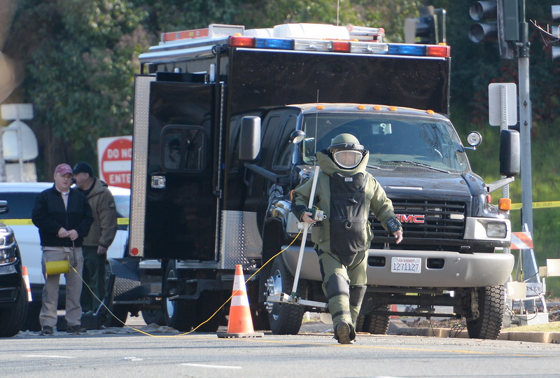 The Butte County Inter-Agency Bomb Squad was called out after CHP reported a suspicious device near the entrance to Beatniks on E. 8th St. in Chico, Calif. Mon. Jan. 30, 2017. E. 8th Street was closed for roughly two hours until after the bomb technicians detonated a water charge on the device.  (Bill Husa -- Enterprise-Record)