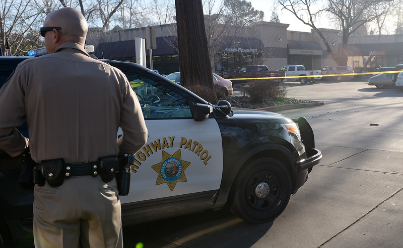 The Butte County Inter Agency Bomb Squad was called out after CHP first reported a suspicious device near the entrance to Beatniks on E. 8th St. in Chico, Calif. Mon. Jan. 30, 2017. E. 8th Street was closed for roughly two hours until after the bomb technicians detonated a water charge on the device.  (Bill Husa -- Enterprise-Record)