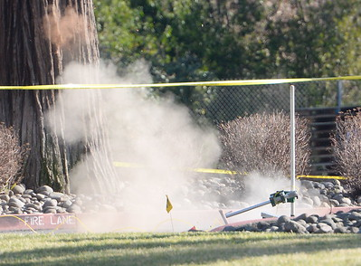 A suspicious device is blasted by the Butte County Inter-Agency Bomb Squad near Beatniks on E. 8th St. in Chico, Calif. Mon. Jan. 30, 2017.  (Bill Husa -- Enterprise-Record)