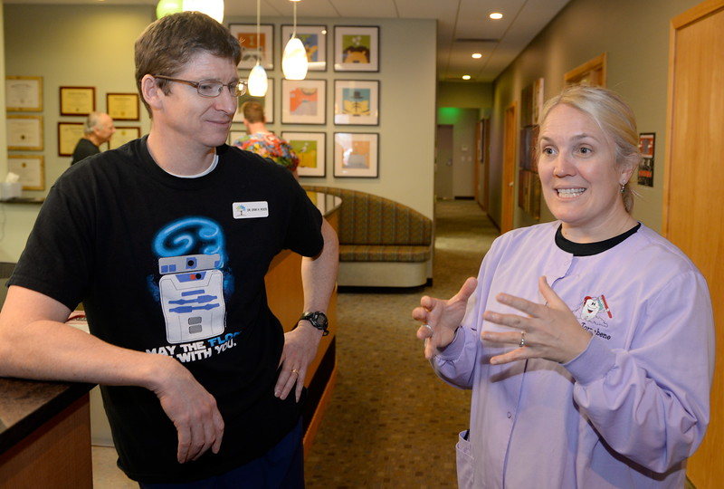Dr. Erik Roos at left and Dr. Ann Tornabene were among some of the 15 Dentists and their associated staffs helping provide free dental care to needy children during the Youthful Smiles program at Chico Pediatric Dentistry Friday Feb. 3, 2017. (Bill Husa -- Enterprise-Record)