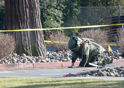 The Butte County Inter Agency Bomb Squad was called out after CHP reported a suspicious device near the entrance to Beatniks on E. 8th St. in Chico, Calif. Mon. Jan. 30, 2017. E. 8th Street was closed for roughly two hours until after the bomb technicians detonated a water charge on the device.  (Bill Husa -- Enterprise-Record)