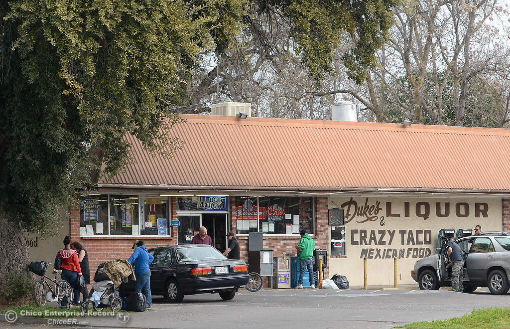 . Dukes Liquor appears to be a popular place on a Friday afternoon in Chico, Calif. Friday March 9, 2018. (Bill Husa -- Enterprise-Record)