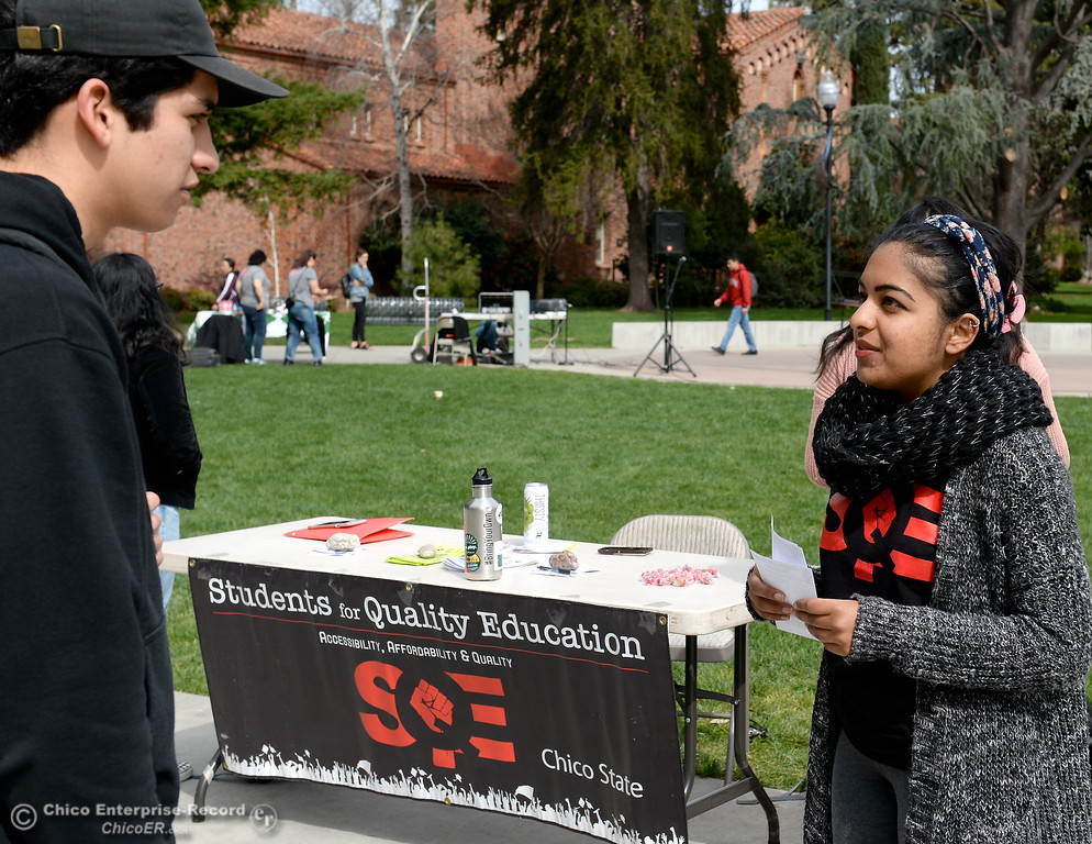 . Ezequiel Garcia left talks with Radhika Kataria beside the Students for Quality Education table during International Women\'s Day rally and celebration at CSUC Thurs. March 8, 2018. (Bill Husa -- Enterprise-Record)