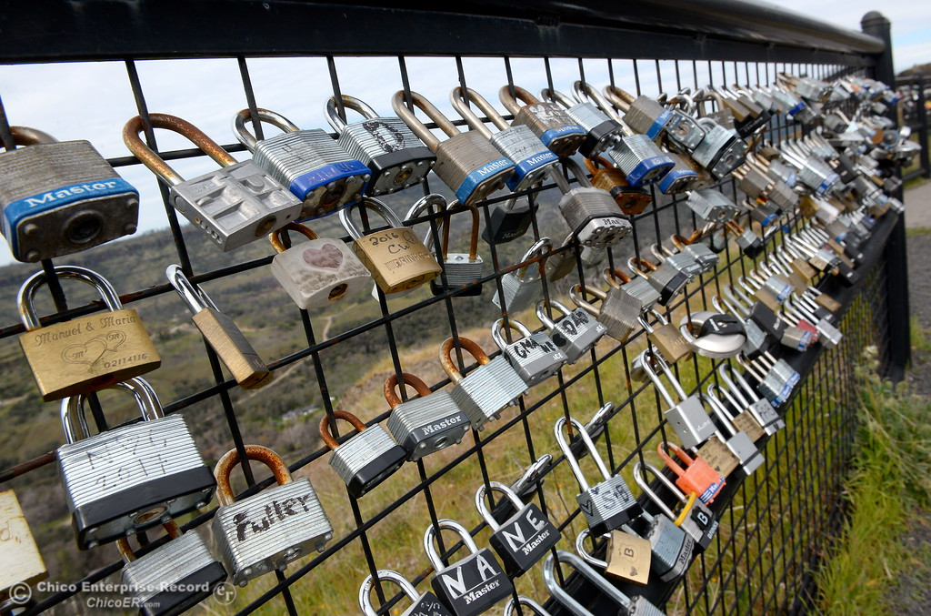 ". Locks of every shape, size, brand and style have been accumulating on the barrier fence at Lookout Point since shortly after the fence was erected. They\'ve been known as ""Locks of Love\"" or \""Love Locks\"" by some. Many are marked with messages or decorated in one way or another dedicated to a lover, a friend or a relative who has passed. (Bill Husa -- Enterprise-Record)"