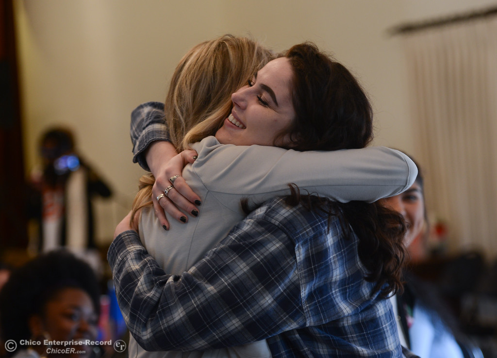 . Audrey Denney hugs Morgan Tanskley during an Women\'s Day event at the Chico Women\'s Club, Saturday, March 10, 2018, in Chico, California. (Carin Dorghalli -- Enterprise-Record)